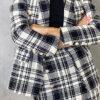blazer americana cuadros blanco y negro forrada detalle botones bosillos solapa