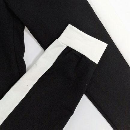conjunto chandal negro banda lateral blanca sudadera corta y pantalon ajustado low cost
